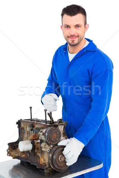 Smiling male mechanic repairing car engine Stock photo © wavebreak_media