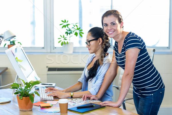 Sorridente parceria computador escritório reunião Foto stock © wavebreak_media
