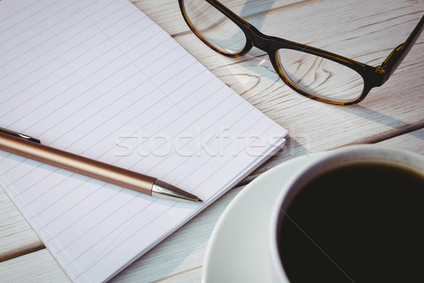 пусто блокнот очки для чтения Кубок кофе столе Сток-фото © wavebreak_media