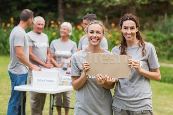 Happy volunteer family holding donation boxes  Stock photo © wavebreak_media