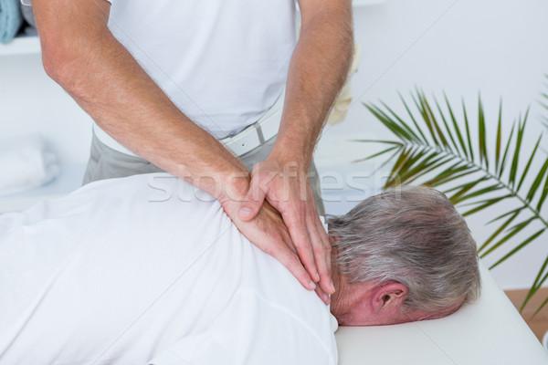 Pescoço massagem paciente médico escritório homem Foto stock © wavebreak_media