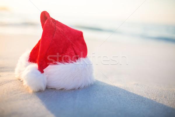 Santa hat on the beach  Stock photo © wavebreak_media