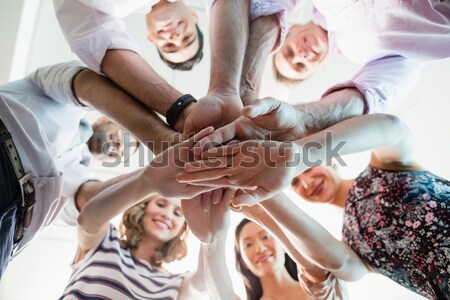 Boldog önkéntesek kezek együtt alulról fotózva férfi Stock fotó © wavebreak_media