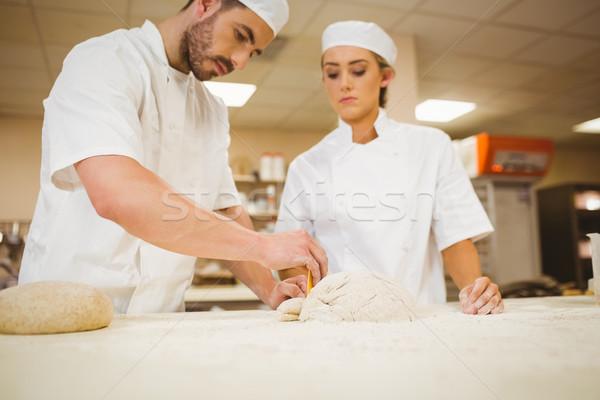 Team of bakers preparing dough Stock photo © wavebreak_media