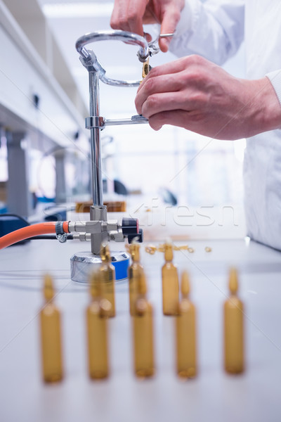 Close up of a biochemist sealing a vial Stock photo © wavebreak_media
