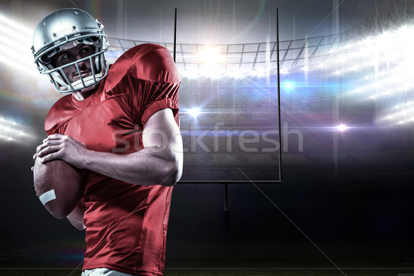 Stock photo: Composite image of american football player in red jersey throwi