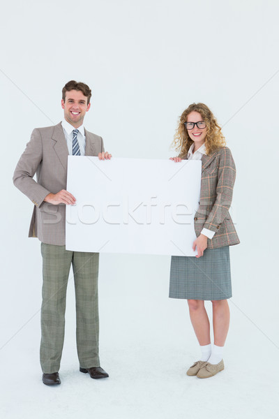 Hipster couple holding poster smiling at camera Stock photo © wavebreak_media