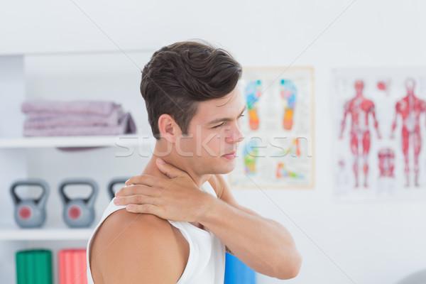 Moço sofrimento dor no ombro médico escritório corpo Foto stock © wavebreak_media
