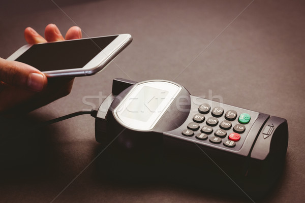 Man using smartphone to express pay  Stock photo © wavebreak_media