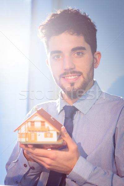 Businessman showing a key Stock photo © wavebreak_media