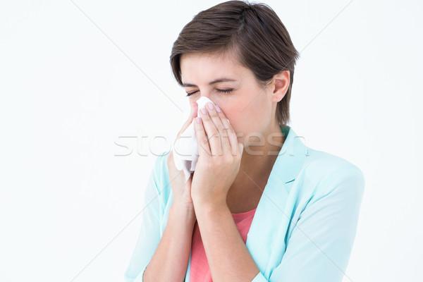 Casual brunette blowing her nose  Stock photo © wavebreak_media