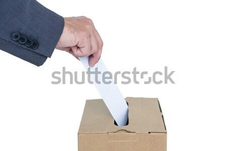 Businessman putting ballot in vote box Stock photo © wavebreak_media