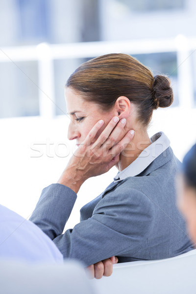 Sad businessman sitting at his desk  Stock photo © wavebreak_media