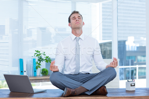Zen businessman doing yoga meditation  Stock photo © wavebreak_media