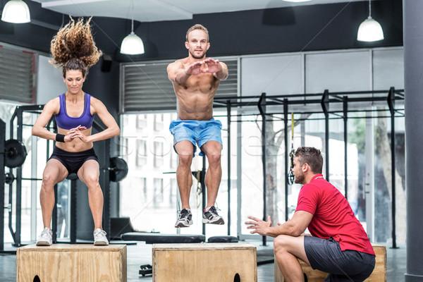 Two muscular athletes doing jumping squats  Stock photo © wavebreak_media