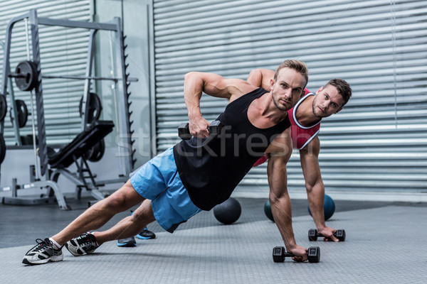 Muscular men doing a side plank Stock photo © wavebreak_media