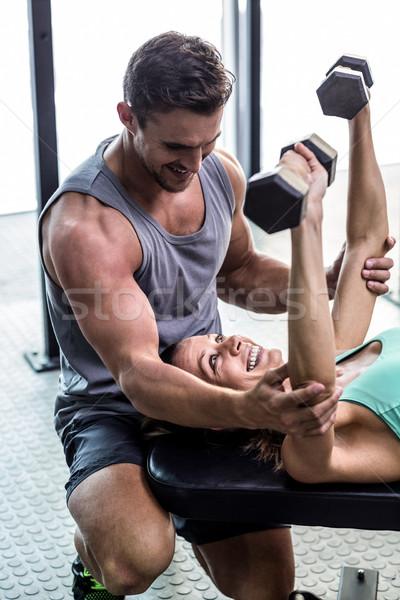 мышечный женщину гантели тренер человека Сток-фото © wavebreak_media