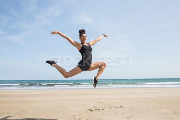 フィット 女性 砂 ビーチ 幸せ 海 ストックフォト © wavebreak_media