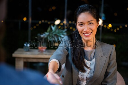 Işkadını el sıkışmak iş arkadaşı portre ofis toplantı Stok fotoğraf © wavebreak_media
