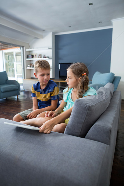 Siblings interacting with each other in living room Stock photo © wavebreak_media