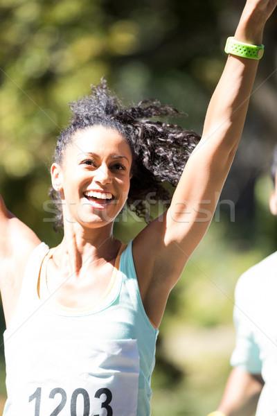 Vrouwelijke atleet winnend marathon race opgewonden Stockfoto © wavebreak_media