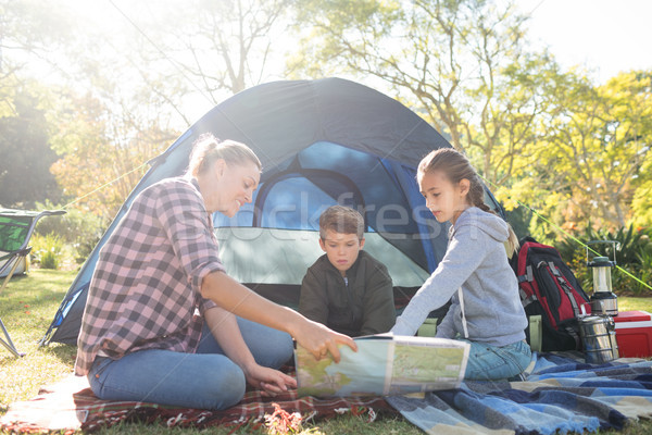 Family reading the map outside the tent Stock photo © wavebreak_media