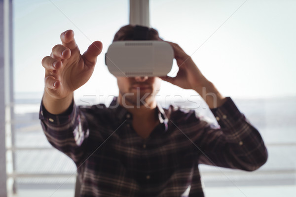 Businessman gesturing while using virtual reality headset in office Stock photo © wavebreak_media