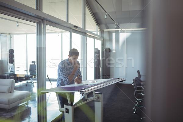 Interior designer working in creative office Stock photo © wavebreak_media