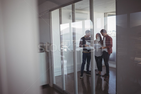 Business colleagues dicussing over documets at office Stock photo © wavebreak_media