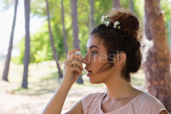 Woman using asthma inhaler in the park Stock photo © wavebreak_media