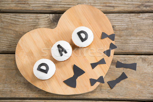 Overhead view of cupcakes with dad text by bow ties Stock photo © wavebreak_media