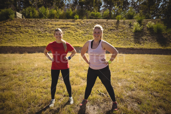 Portrait of happy women exercising during obstacle course Stock photo © wavebreak_media