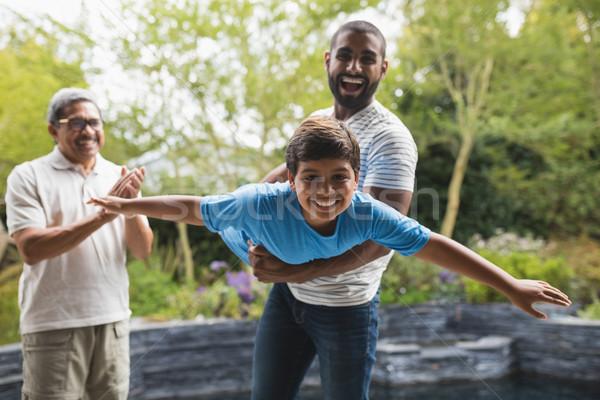 Szczęśliwy rodziny parku wraz chłopca Zdjęcia stock © wavebreak_media