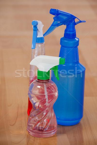Három különböző spray üvegek fapadló közelkép Stock fotó © wavebreak_media