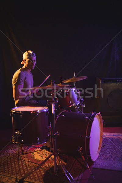 Confident male performing with drum kit in nightclub Stock photo © wavebreak_media