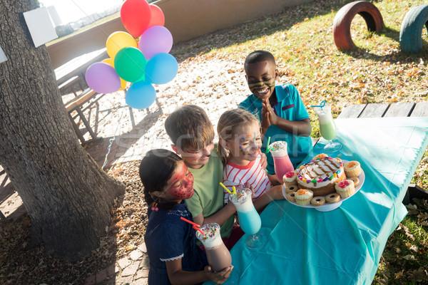Gelukkig kinderen gezicht verf voedsel dranken Stockfoto © wavebreak_media