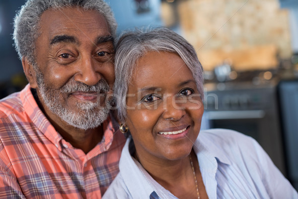 Close up portrait of smiling couple at home Stock photo © wavebreak_media