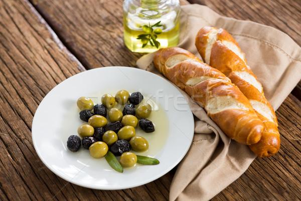 Gemarineerd olijven olijfolie ontbijt houten tafel voedsel Stockfoto © wavebreak_media