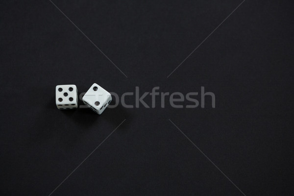 High angle view of white dices Stock photo © wavebreak_media
