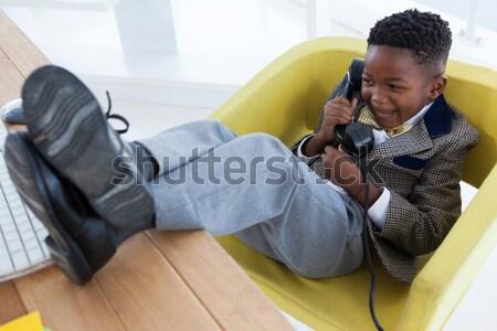 Side view of girl using phone Stock photo © wavebreak_media