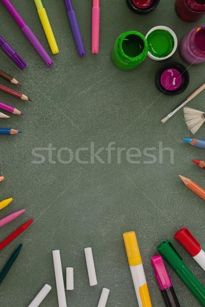 Various drawing equipment arranged on chalkboard Stock photo © wavebreak_media