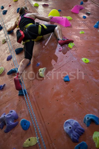 Woman practicing rock climbing in fitness studio Stock photo © wavebreak_media