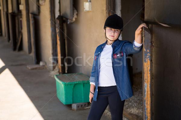 Girl standing in the stable Stock photo © wavebreak_media