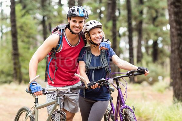 Happy young biker couple looking at camera Stock photo © wavebreak_media