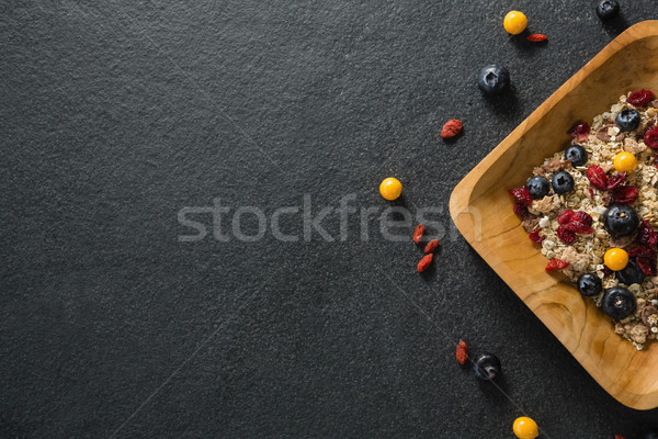 Plate of breakfast cereal with fruits on black background Stock photo © wavebreak_media