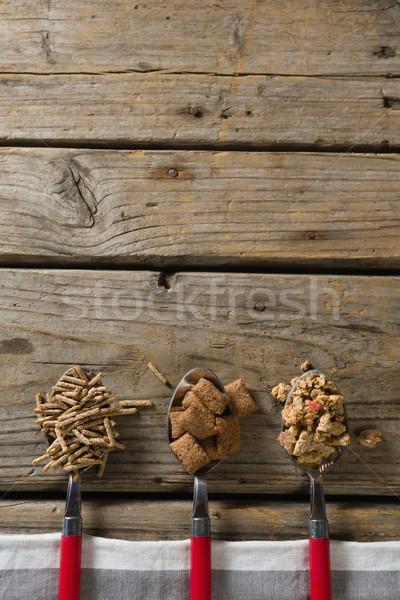 Trzy różny śniadanie zboża drewniany stół Zdjęcia stock © wavebreak_media