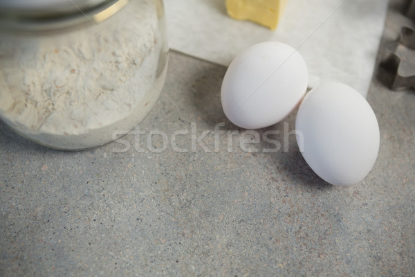 Vue oeufs farine verre jar Photo stock © wavebreak_media