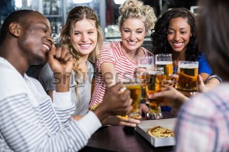 Derűs fiatal barátok ül étel ital Stock fotó © wavebreak_media