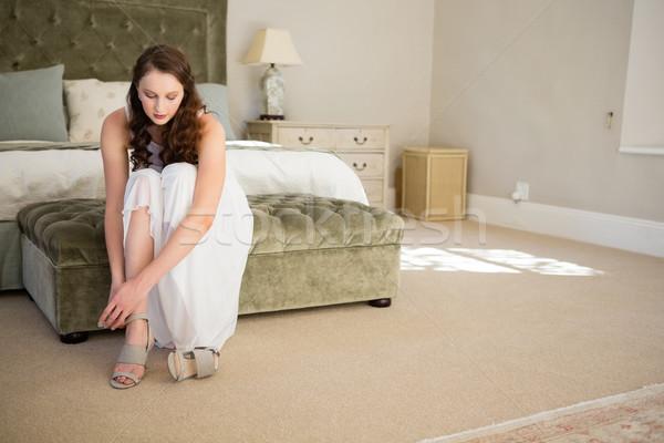 Beautiful bride wearing sandals in bedroom Stock photo © wavebreak_media