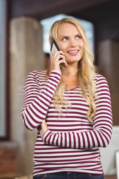 Businesswoman talking over phone  Stock photo © wavebreak_media